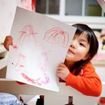 pre-K girl with drawing